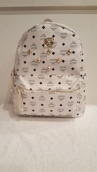 white and gray MCM worldwide backpack