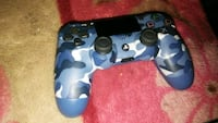 blue and black camouflage Sony PS4 controller 1959 mi