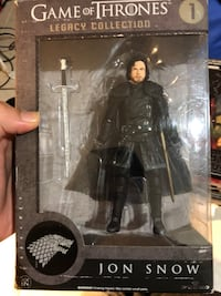 black and gray action figure 50 km