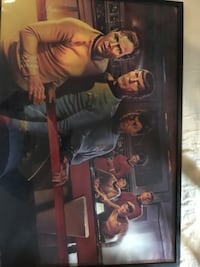 Framed Star Trek poster behind glass