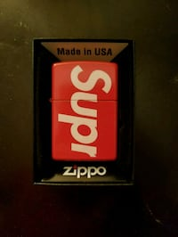 red and white Supreme Zippo lighter with box Chicago, 60629