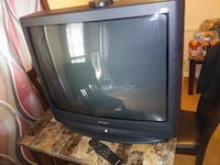 "32"" inch Panasonic old school TV with remote."