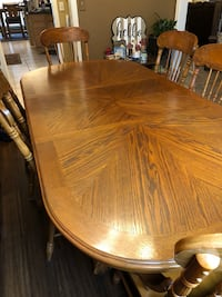 oval brown wooden dining table with chairs Jenks, 74037