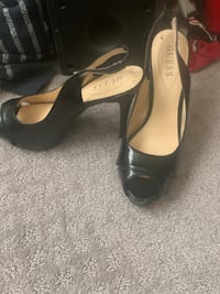 Pair of black leather peep toe heels guess brand worn maybe 4 or 5 times