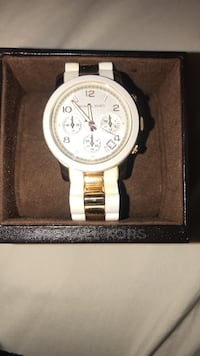 Round white Michael Kors chronograph watch with rose gold link bracelet