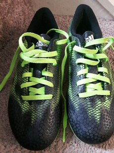 green-and-black Adidas lace running shoes