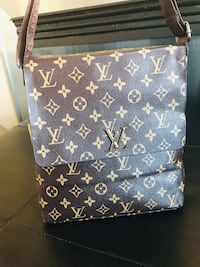 Brown Louis Vuitton leather crossbody or messenger bag  Edmonton