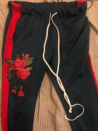 Dark green and red floral sweat pants Philadelphia, 19138