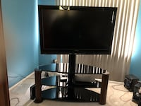 black flat screen TV with black wooden TV stand Dunkirk, 20754