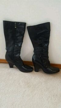 pair of black leather knee high boots Calgary, T3A 1G5