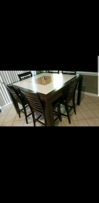 rectangular brown wooden table with six chairs din Woodbridge, 22193