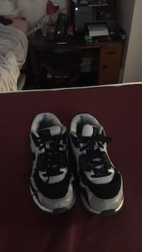 pair of black-and-white Nike basketball shoes College Station, 77840