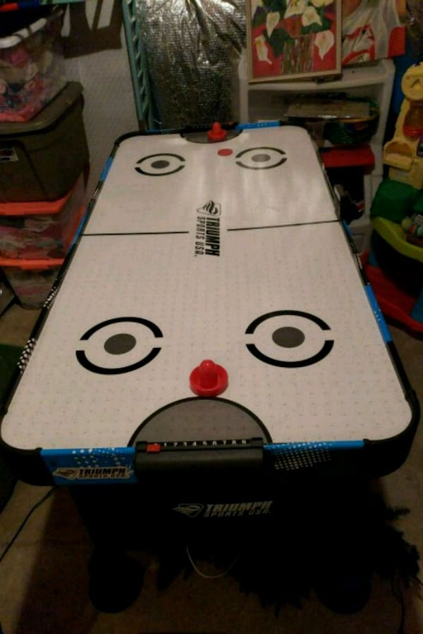 kids air hockey table  71fd3723-ae32-423c-9be3-bb07be45535d