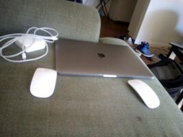 MacBook Pro with 2 wireless mouses