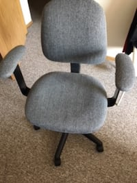 gray and black rolling armchair null
