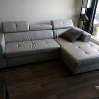 Grey leather adjustable pull out couch Coquitlam
