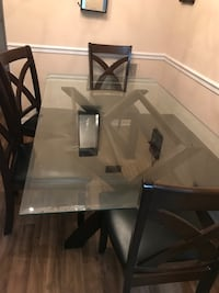 Table with 4 chairs and a bench