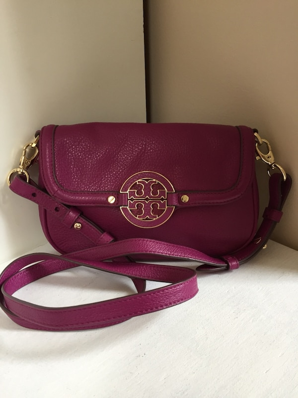 bacc5ba7111f Used purple leather Tory Burch sling bag for sale in Springwater - letgo