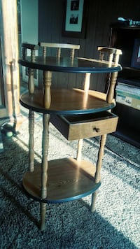 round brown wooden framed glass top table Los Banos