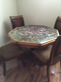 octagonal brown wooden framed marble tile top table and four chairs dining set Toronto, M9P 1A9