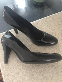 Pair of black leather heeled shoes.