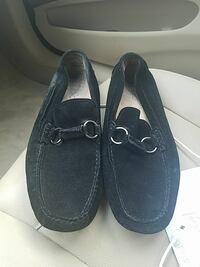 pair of black suede penny loafers