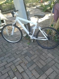 white and black hardtail bike 1161 mi