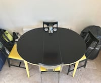 Round black wooden table with 4 yellow chair set