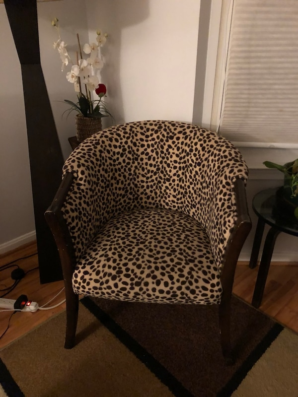 brown wooden framed black and white padded chair
