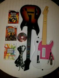 two assorted-color Guitar Hero game controllers Des Moines, 50317
