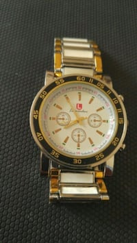 round gold-colored chronograph watch with link bra Beauharnois, J6N 2B9