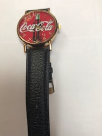 round gold analog watch with black leather strap Falls Church, 22041