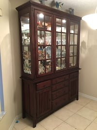 brown wooden framed glass display cabinet Lake Worth, 33463
