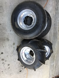 two black-and-gray car wheels