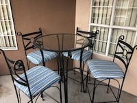 Round glass top patio table with four chairs New Westminster, V3M 6E1