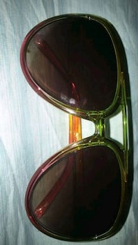 gold-colored framed sunglasses 44 km