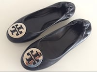 Pair of black tory burch leather flat shoes null