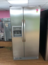 Kenmore gray side by side refrigerator  47 km