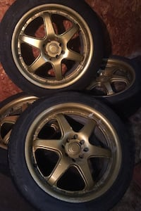 universal 4 holes  205-50-17 with gold alloy rims