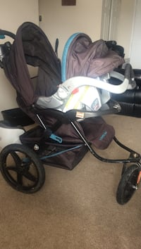 baby's black and blue jogging stroller