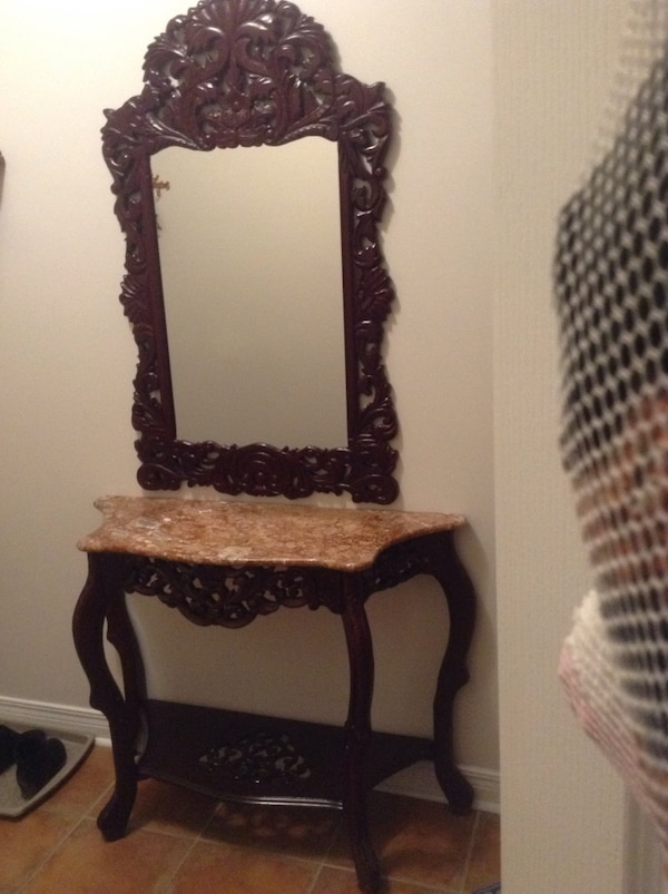 Brown wooden frame wall mirror