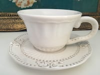 Brand new set of 8 cups and saucers