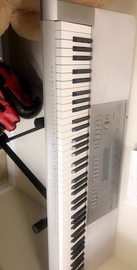 Black and white electronic Casio WK-225 keyboard -Great condition; price negotiable Arlington