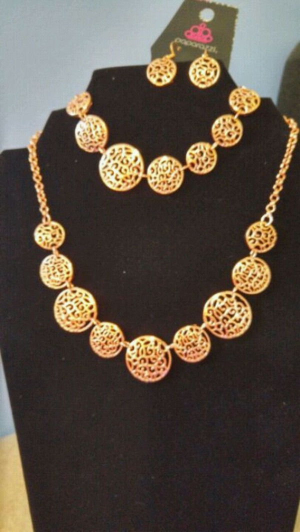 gold and silver necklace and earrings