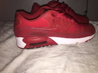 Pair of red nike air max shoes