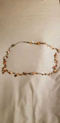 gold-colored beaded necklace 1454 mi