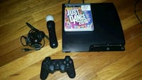 black Sony PS3 slim console with controller and ga