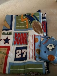 white, blue, and red sports-themed comforter