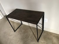 Wooden and wrought iron table