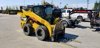 orange and black tractor with plow blade HOUSTON